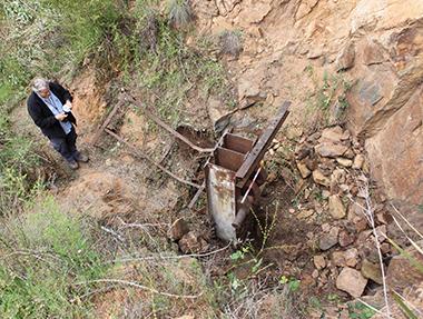 man surveying site