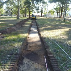 Mechanical test excavation of WWII remains at Titalka Park